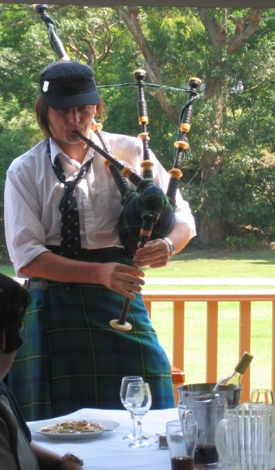 Playing the bagpipes at an IAG Christmas party